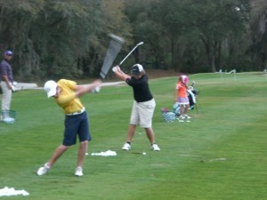 Teens in Tampa practicing golf