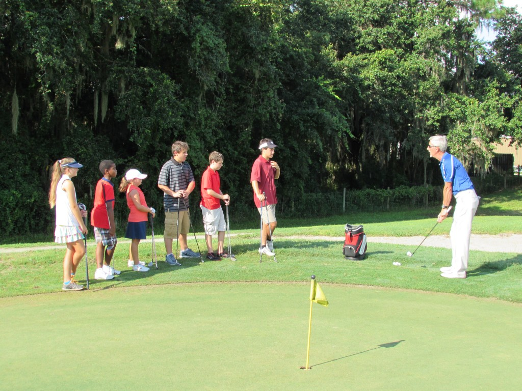 Coach J.D. teaching the kids the art of chipping.